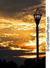 Lamp post - Old lamp post against cloudy evening sky