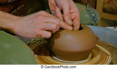 Professional male potter working in workshop, studio....