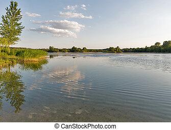 Ballast lake sunset landscape in Voznesensk, Ukraine. -...