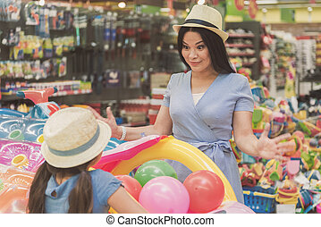 Happy smiling family in supermarket - Surprised mother is...