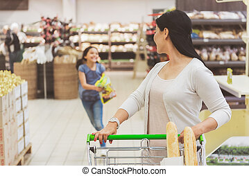 Busy ladies doing funny shopping - Attentive mother is...