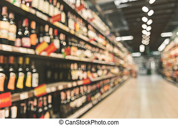 Different alcohol bottles in supermarket