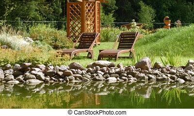 Relaxing on a deck chair by the river on the outdoor