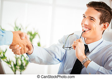 Business Agreement - Two successful business men making a...