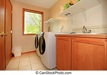Laundry room - Nice laundry room with cherry wood cabinets...