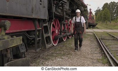 Railway employee go into the locomotive