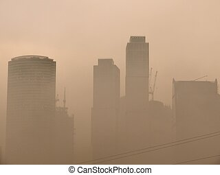 Smog. City.  - A smoke from forest fires over Moscow. Day.