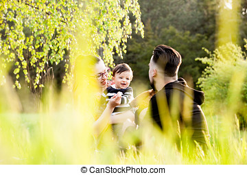 Happy family with her son in the park. Family spending...