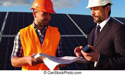 Close up view of business client talking to engineer at...