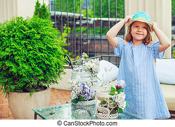 girl in the terrace - happy little girl in the terrace at...