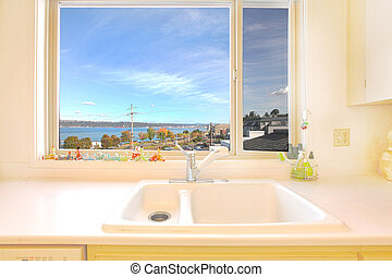 Kitchen sink with a water and city - Kitchen in an an...