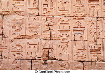 Egyptian hieroglyphs carved on the walls of Karnak temple