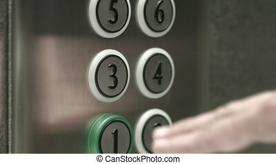 Man presses a button the third floor in an elevator - Man...