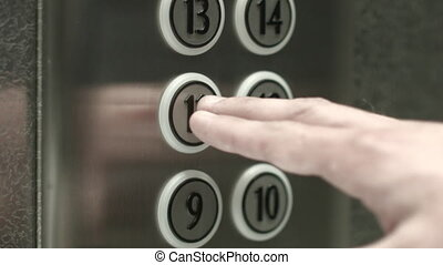 Man presses a button the eleventh floor in an elevator - Man...