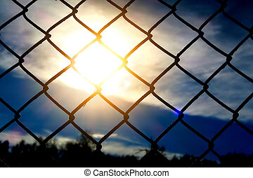 Wire Netting at Sunset - Sun and Sky through Wire Netting...