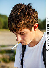Young Man with a Cigarette - Sad Young Man smoking Cigarette...