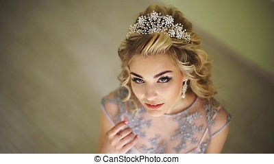 Beautiful fashionable bride. Stylish hair accessories. Blonde curly hair. hairdresser salon, stylist, trendy stylish bright make-up. Pretty woman posing, looking at camera