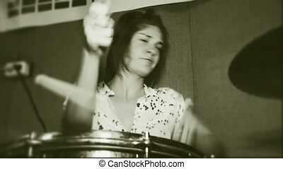 Rock and roll drum - Beautiful young girl who is actively...