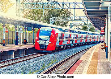 Highspeed train approach to the platform. - Highspeed train...