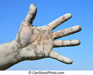 Left male hand with fingers spread out on a blue background