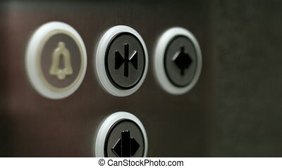 Man pushes a button opening elevator doors - A man pushes a...