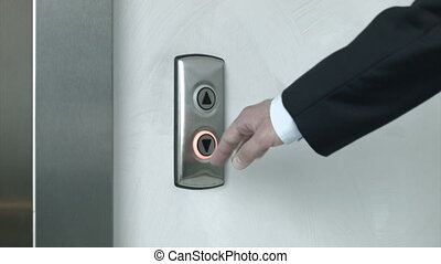Man pressing elevator button to go up and to go down. Close...