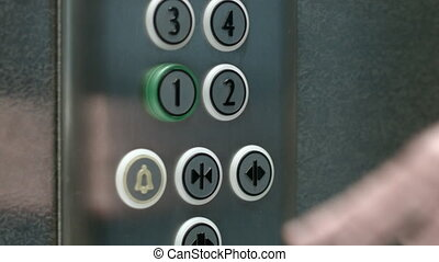 Man presses a button the first floor and a button closing...