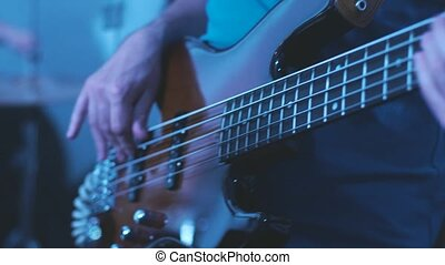 Man Playing Bass Guitar - Man Playing Electrical Bass Guitar