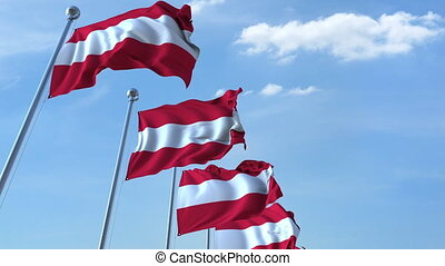 Row of waving flags of Austria agaist blue sky, seamless...