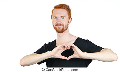 Handsome young man making heart sign with his hands