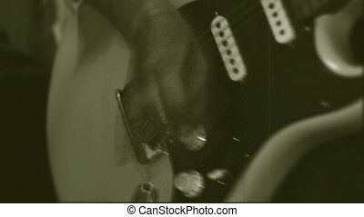 Play musician - Guitarist actively playing the guitar. Black...