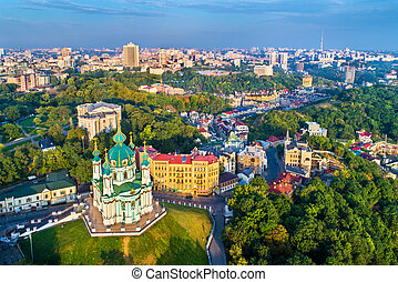 Aerial view of Saint Andrew church and Andriyivskyy Descent, cityscape of Podil. Kiev, Ukraine