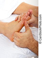 Detail of reflexology massage - Detail of man hands doing...