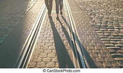 The couple is walking along the tramway.