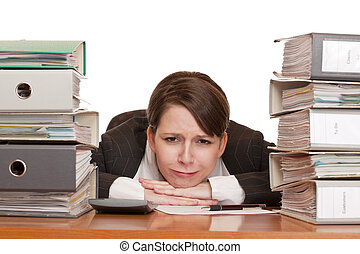 Woman in office with folder stacks is desperate, stressed...
