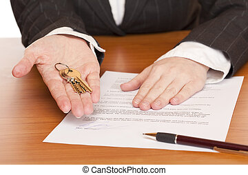 Business woman holds key and contract in hands. Isolated on...