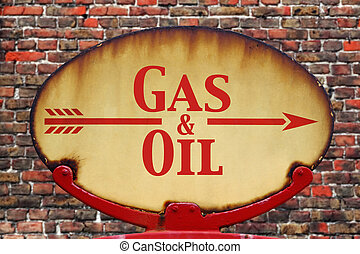 Retro sign Gas and Oil - A rusty old retro arrow sign with...