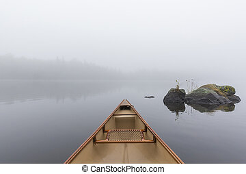 Canoe bow on a misty lake - Ontario, Canada