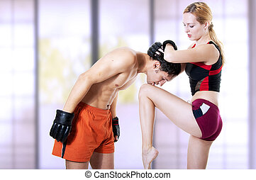 Woman fighter kicking knee in hand - Couple fighters - woman...