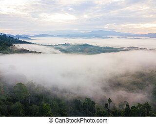 Landscape of misty mountain forest covered hills at khao...