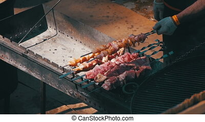 Man Preparing Barbecue on the Food Festival. Slow Motion in...