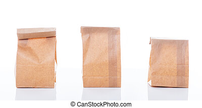 three brown paper bags in front of white background