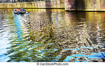 Boat Reflection Singel Canal Amsterdam Holland Netherlands....