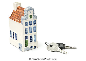 House and keys isolated over white background