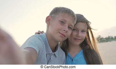 Little sister and elder brother taking selfies