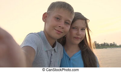 Little brother and sister taking selfie