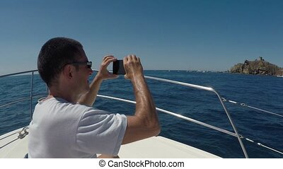 Man Taking Pictures During Navigation