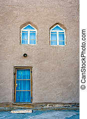 Mud house in Khiva downtown - Mud facade with door and...