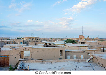 Mud houses in Khiva downtown - Mud houses and rooftops in...