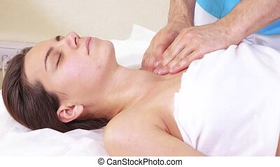 Massage shoulders of girl - Masseur man doing shoulder...